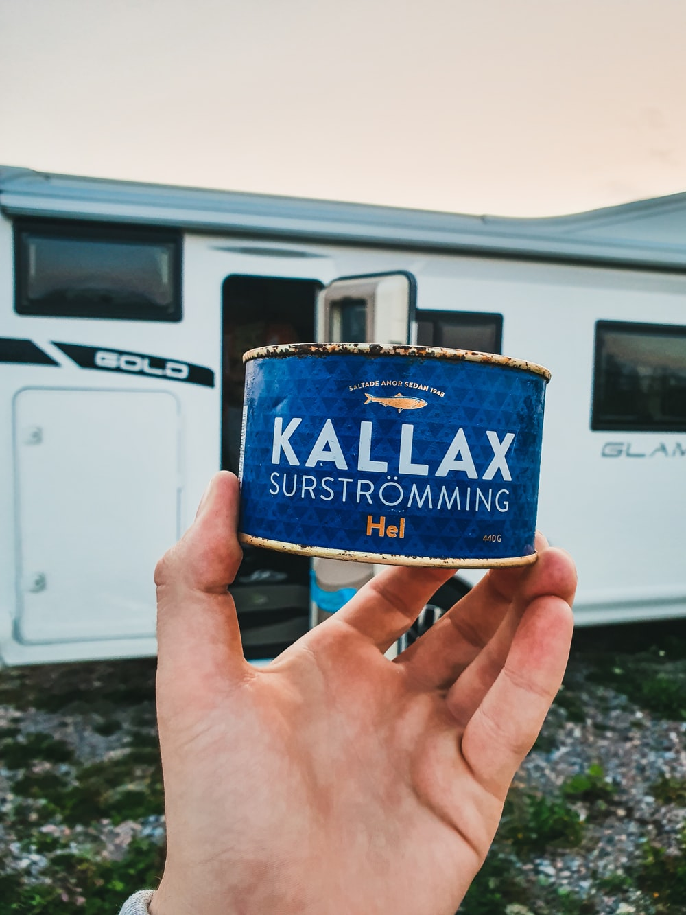 person holding blue Kallax metal container