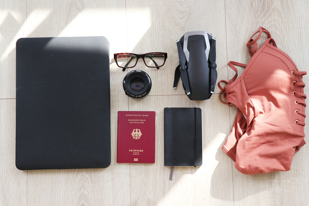 laptop, eyeglasses, passport, notebook, drone and swimsuit