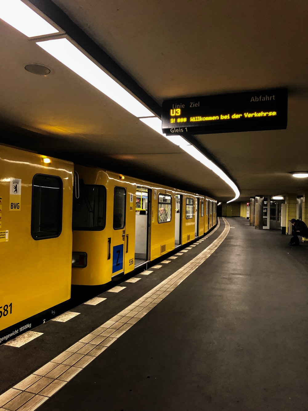 yellow train in the station