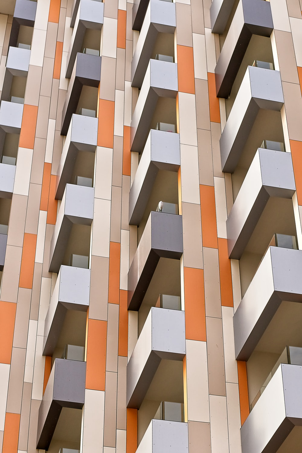 white and orange high-rise building