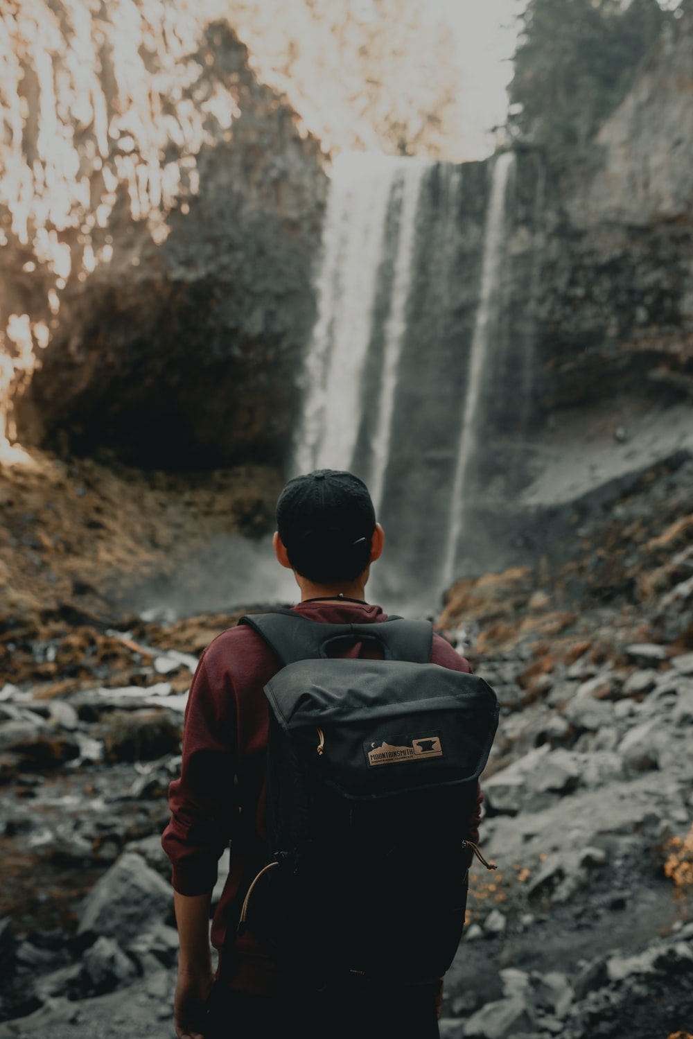man near waterfall