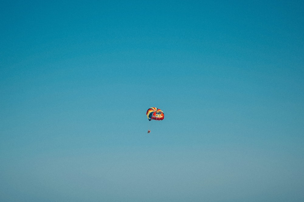 multicolored parachute in the sky during daytime