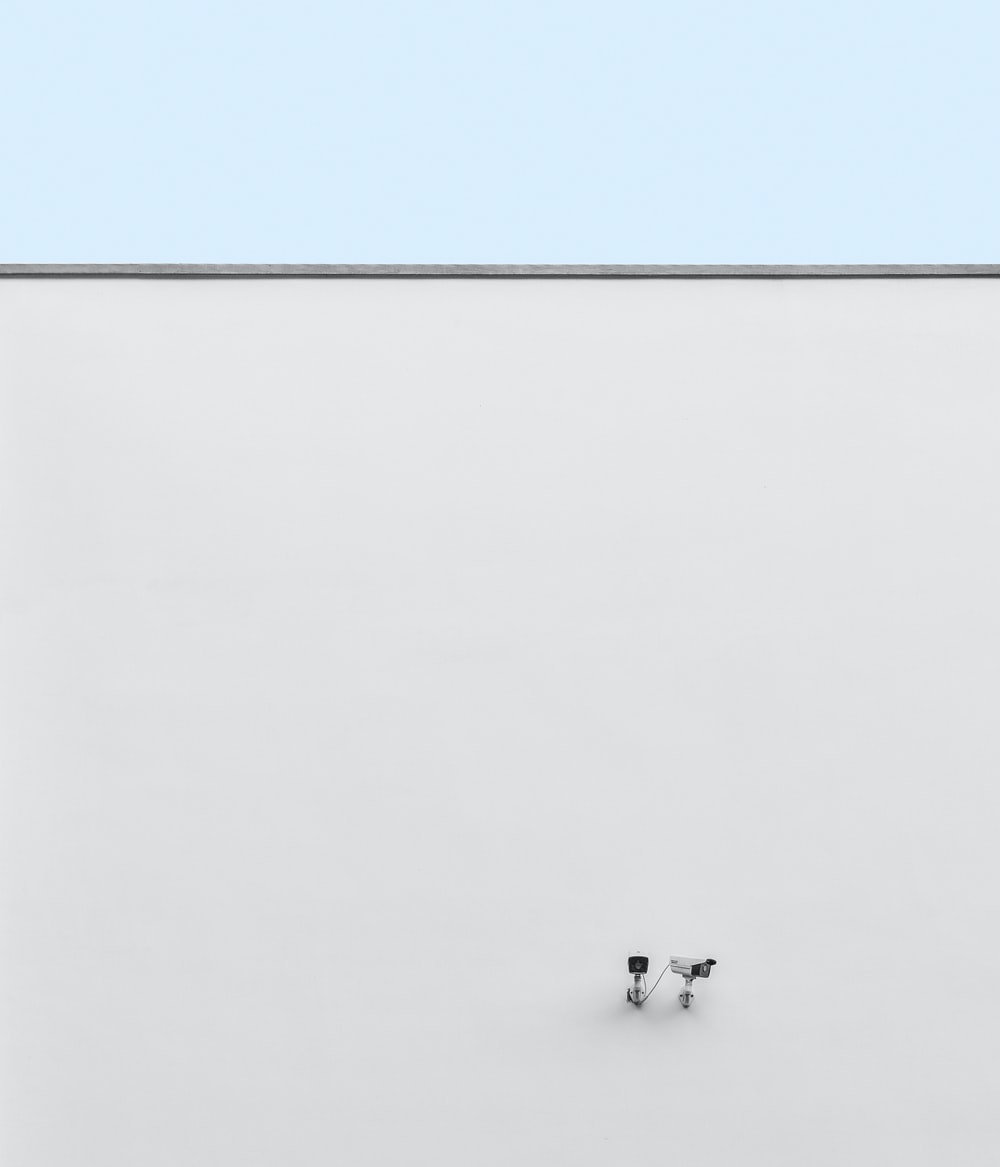 two white bullet IP cameras