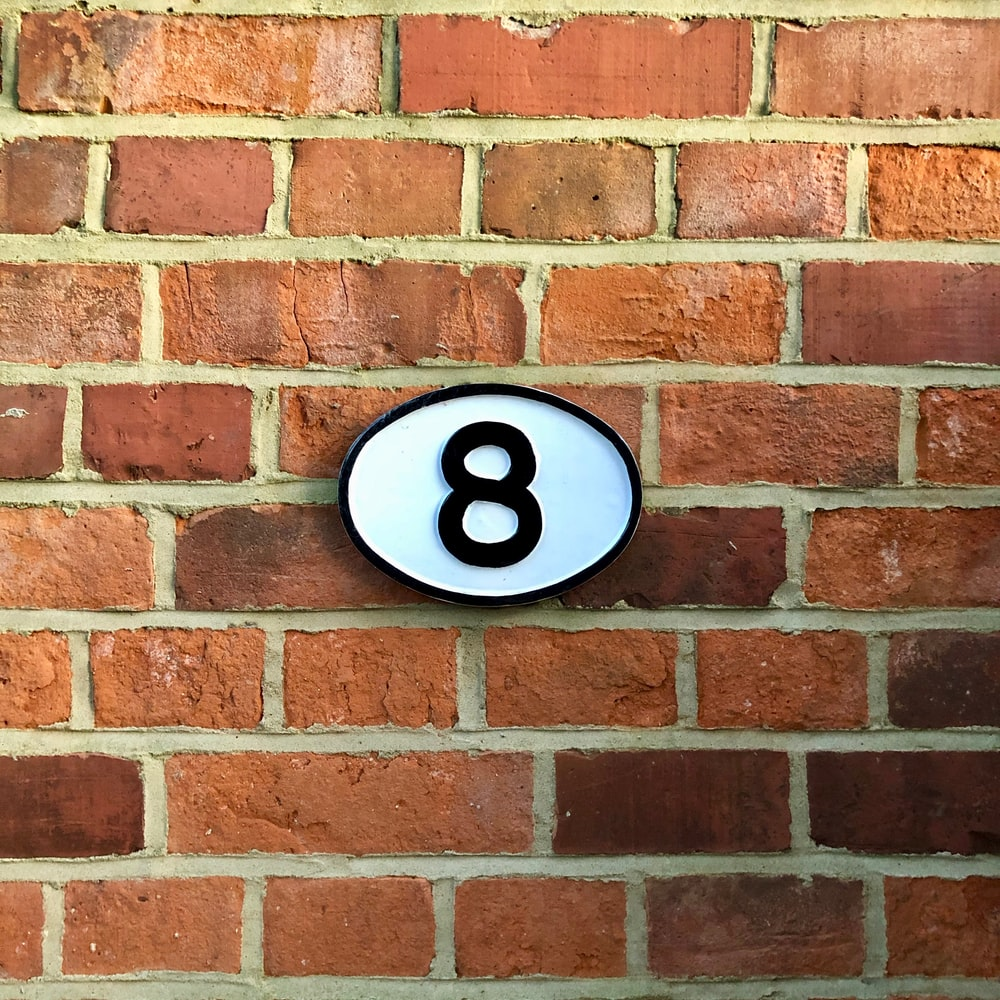 white and black 8 sign