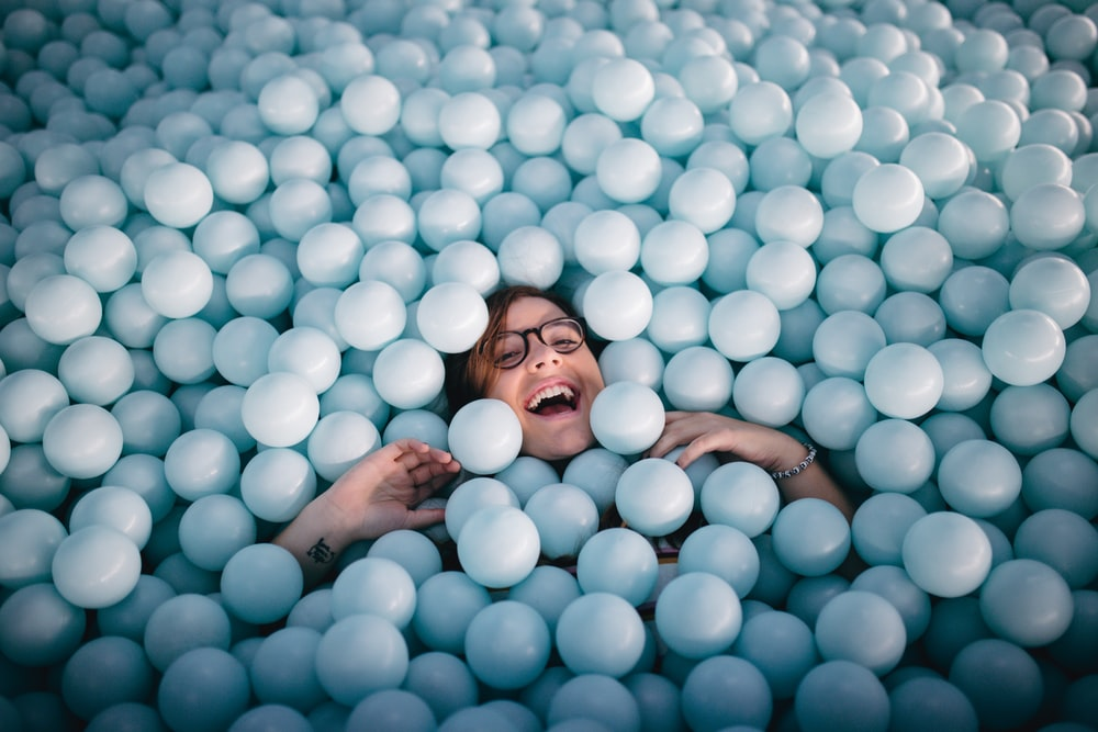 woman in pile of white balls
