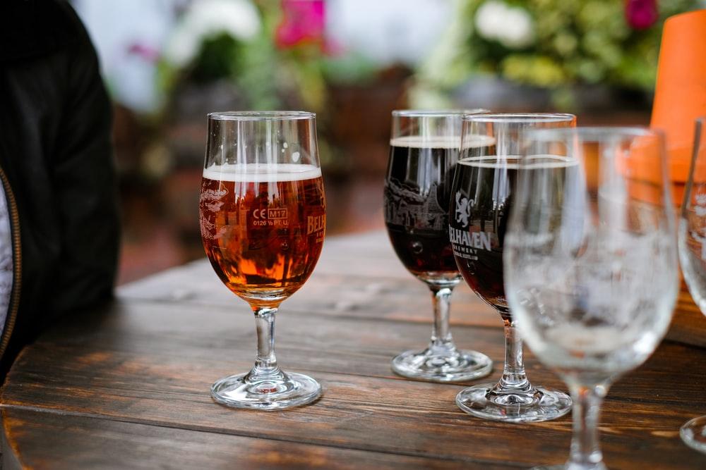 two clear glass wine glasses