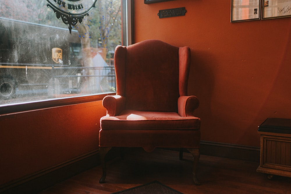 brown wooden framed red padded armchair