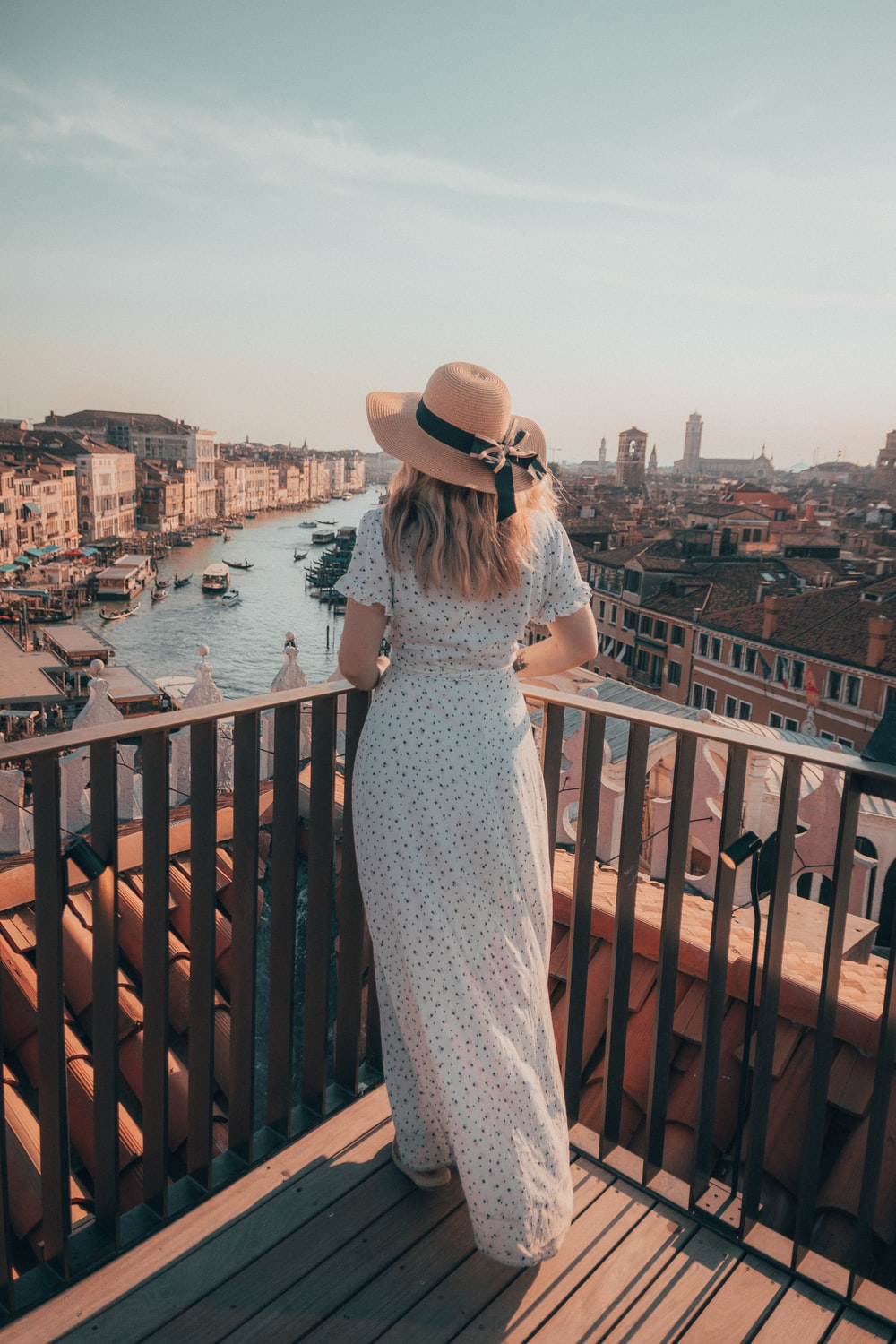 woman in black and white dress looking at city