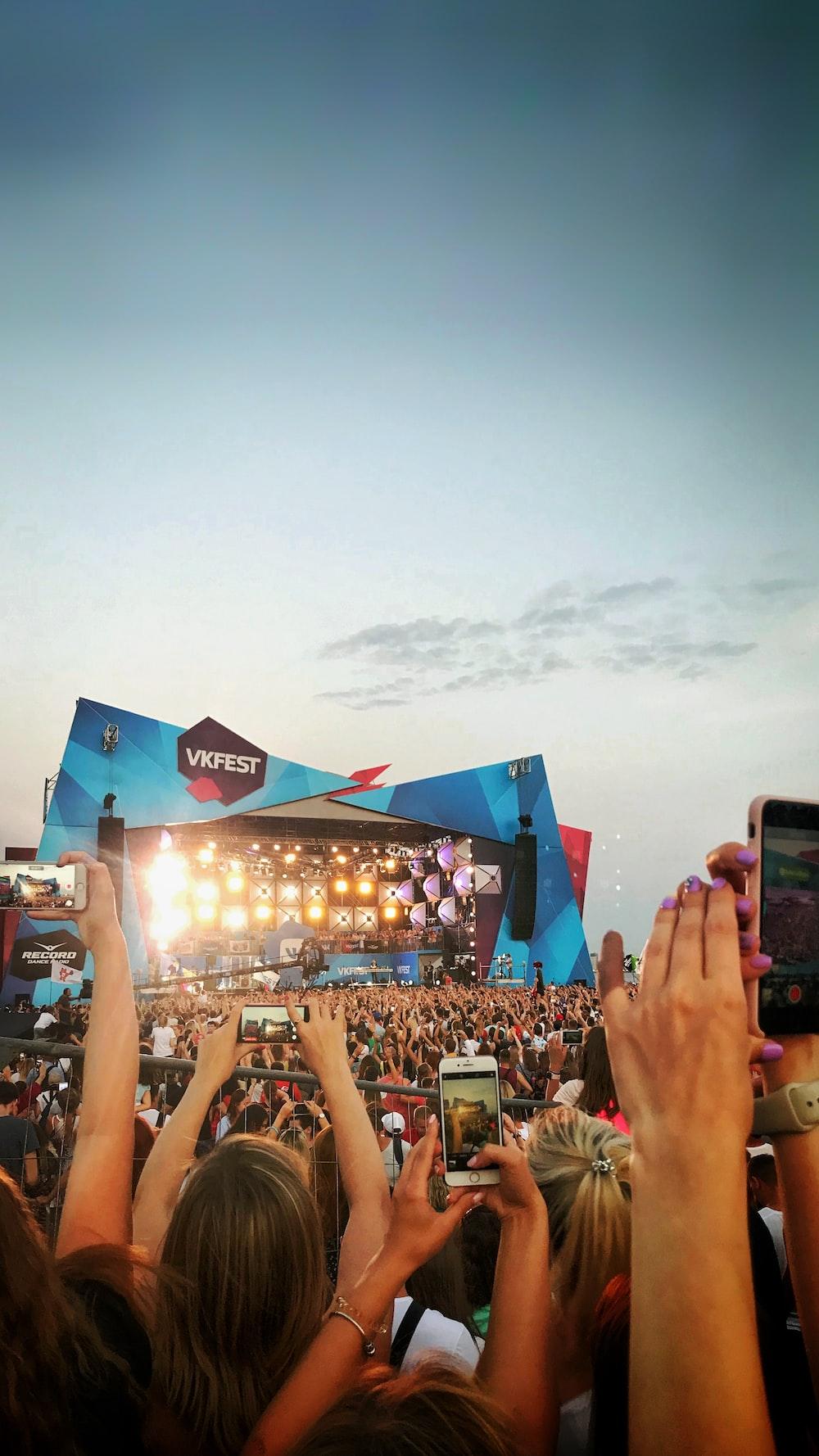 crowd under blue sky