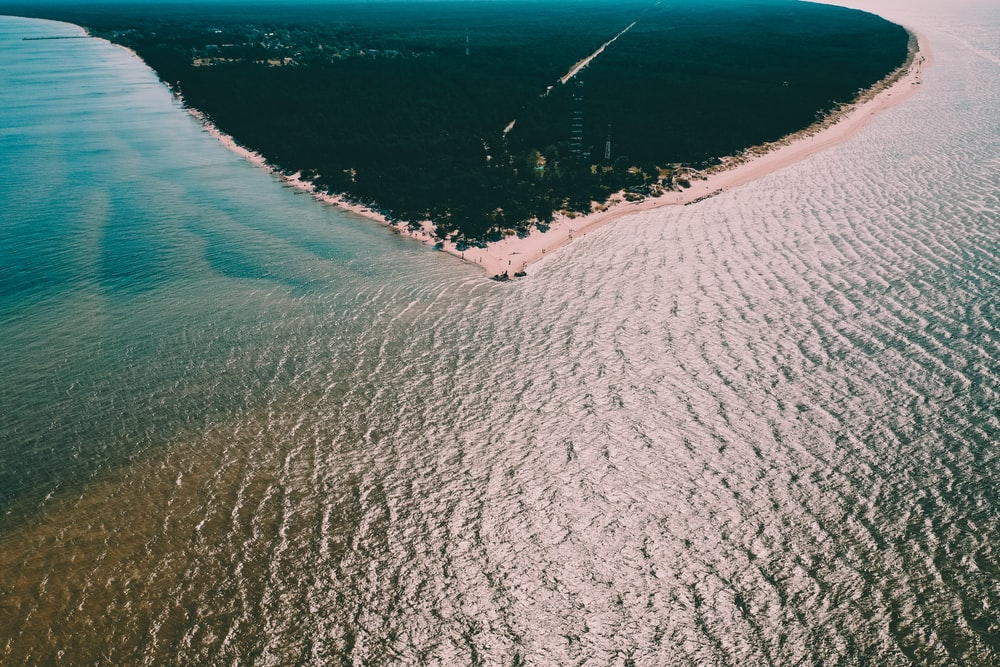 aerial photography of body of water and seashore
