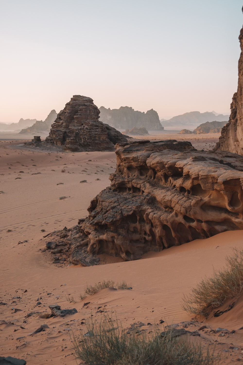 brown rock formation on brown field