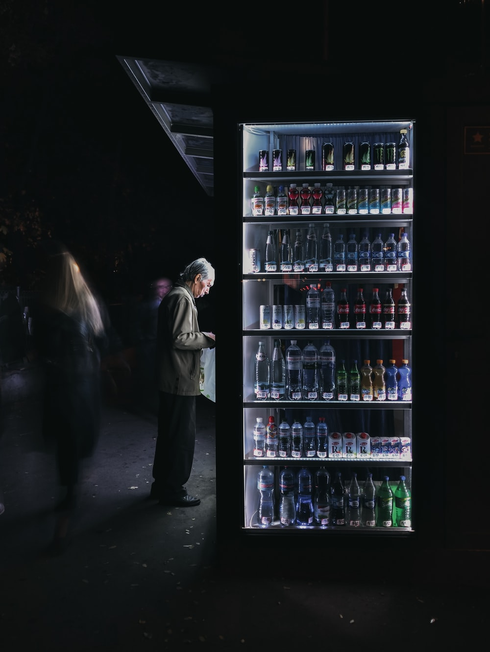 person in front of vending machine