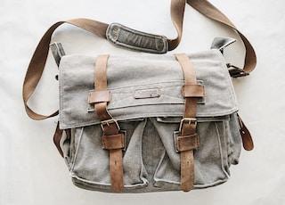 gray and brown messenger bag