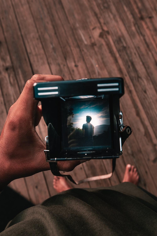 person black land camera during daytime