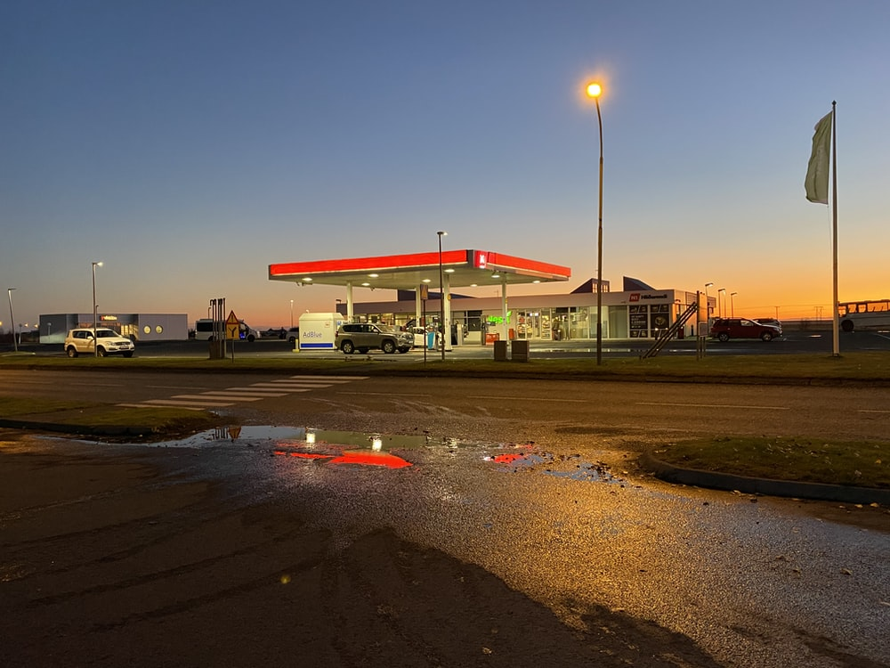 red and white gasoline station under blue sky