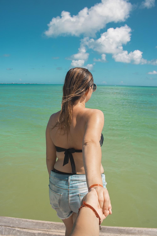 woman standing shore