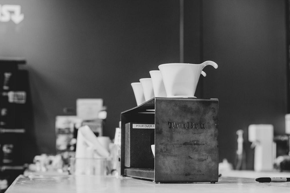 white ceramic cups on box