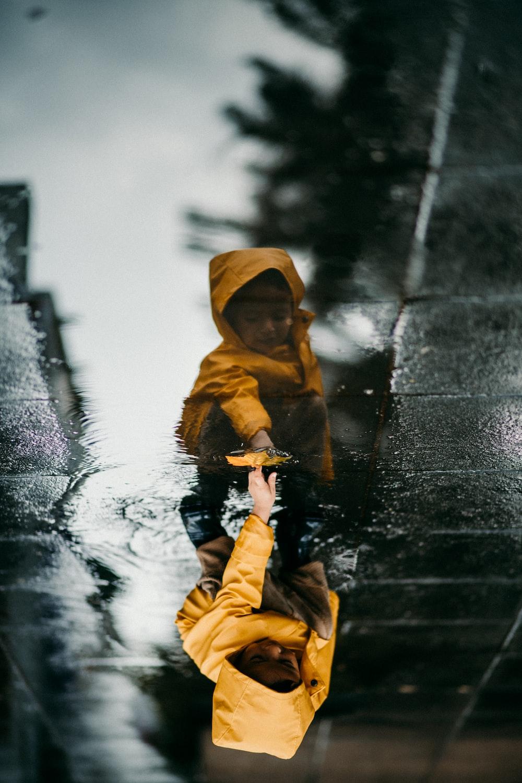 toddler in yellow raincoat