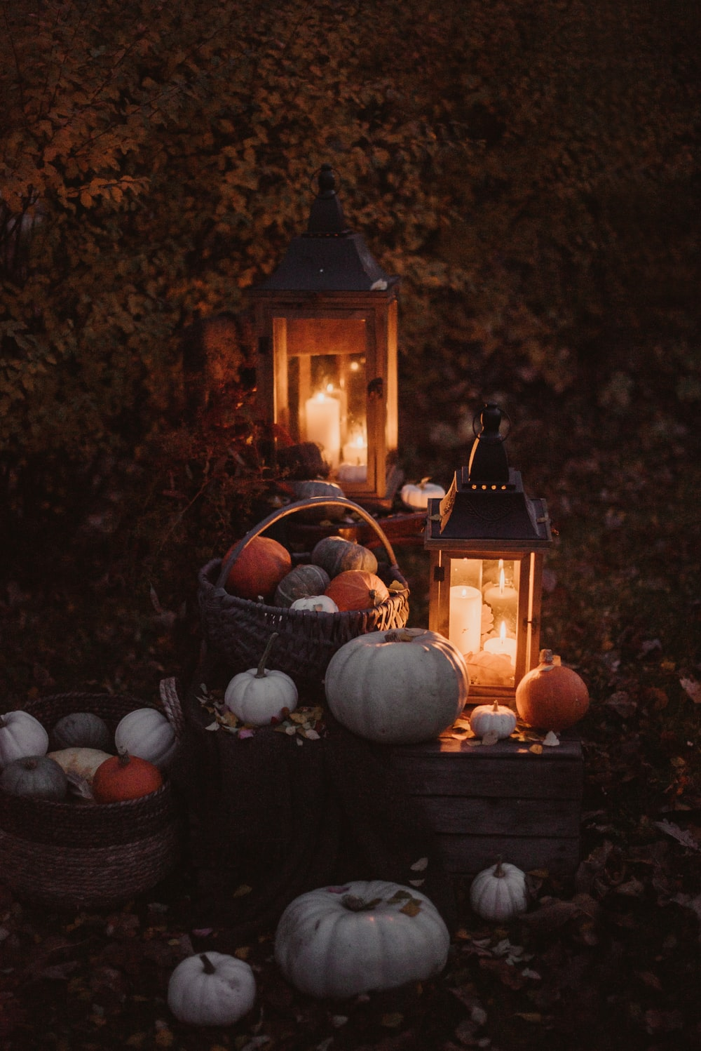 pumpkins and lit candles
