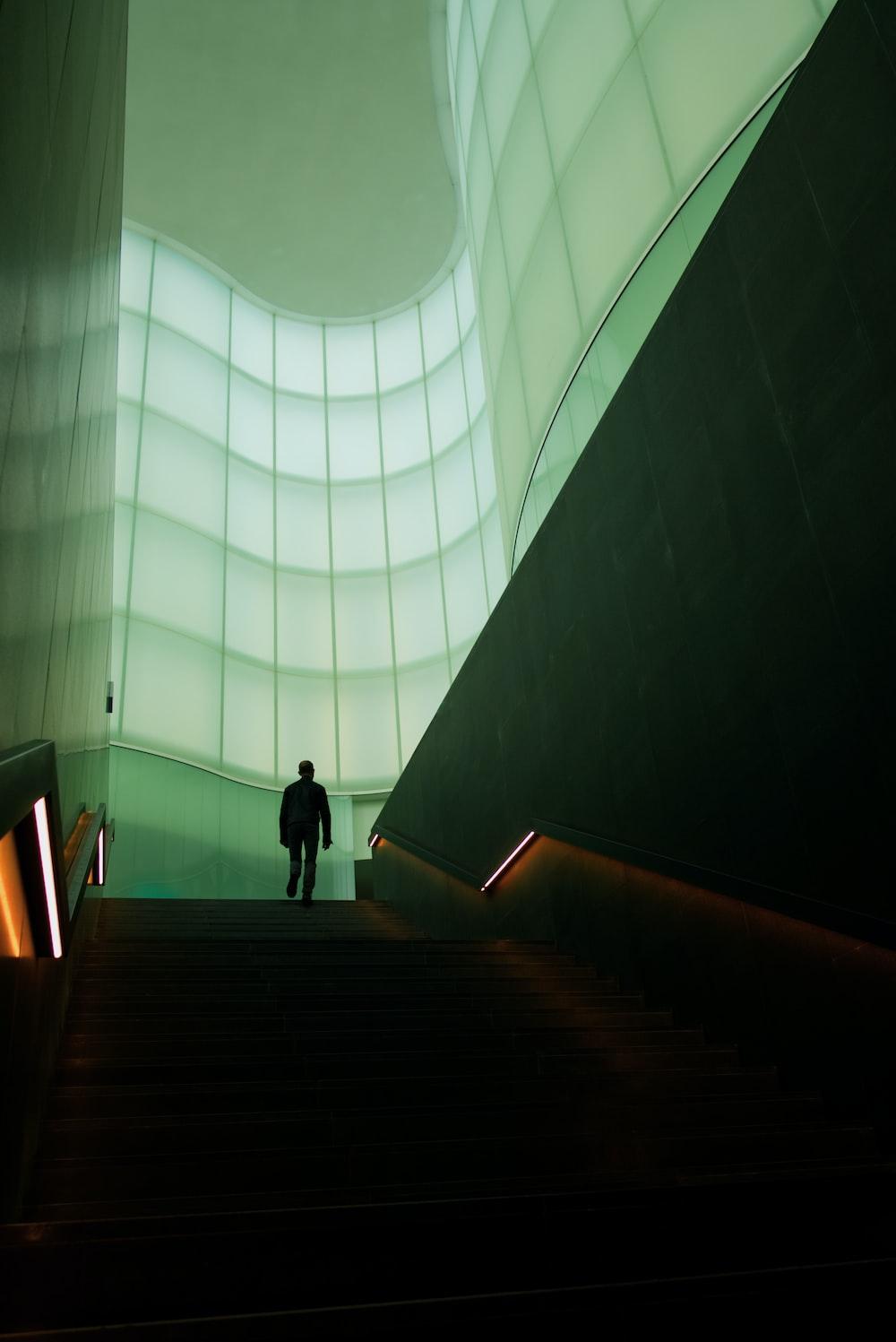 man walking up on stairs