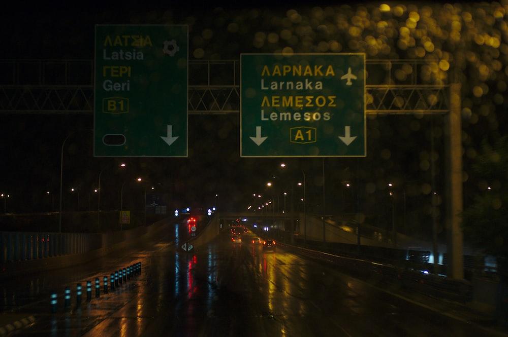 Aapnaka Larnka road sign at night