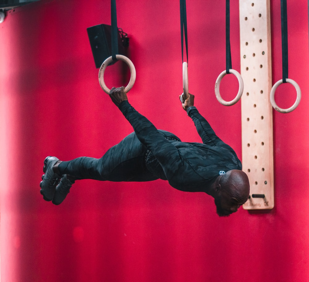 man acrobat on two ring hoops
