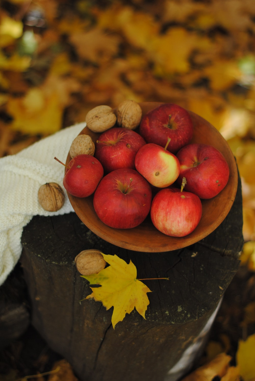 red apple in brown bowl