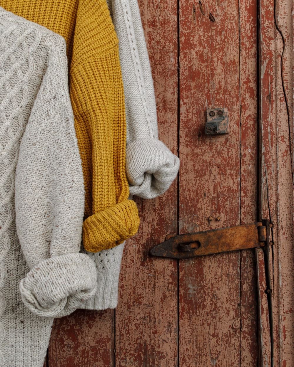 yellow, beige, and grey knitted shirts