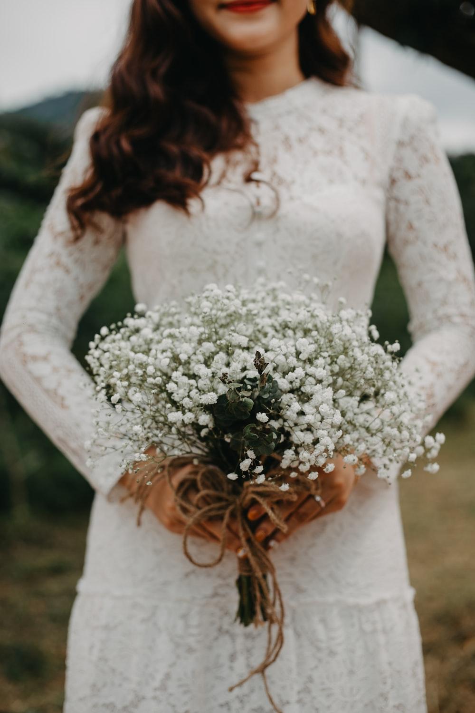 woman in wedding dress holding bouquet