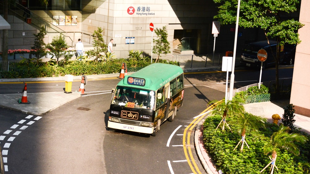 green and black bus during daytime