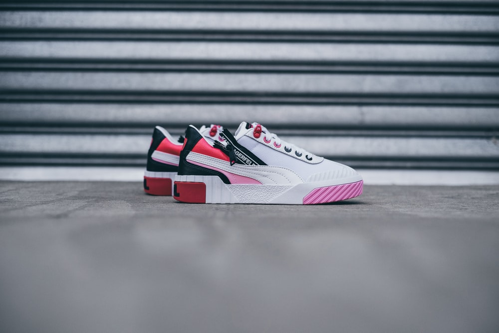 white-black-and-pink low-top sneakers