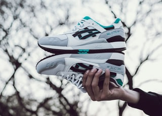 white-and-green low-top shoes