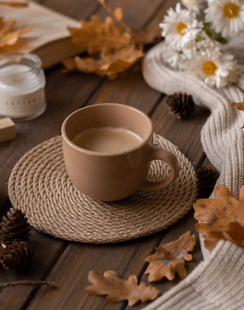 white ceramic cup and saucer