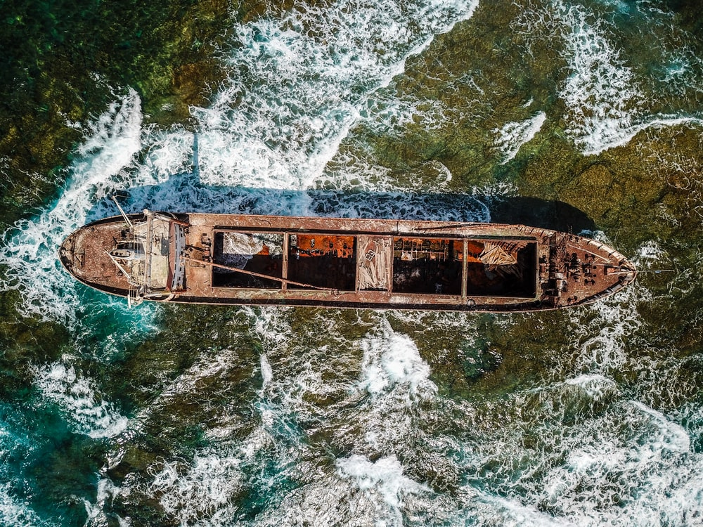 aerial view of brown wooden row boat on shore