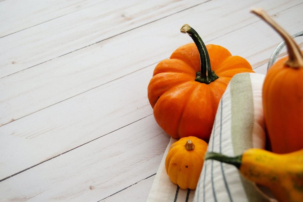 pumpkins on wooden surface