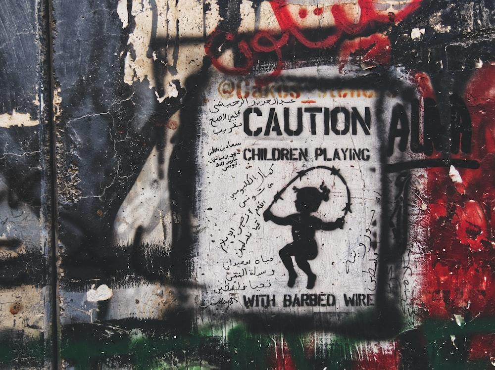 caution children playing graffiti