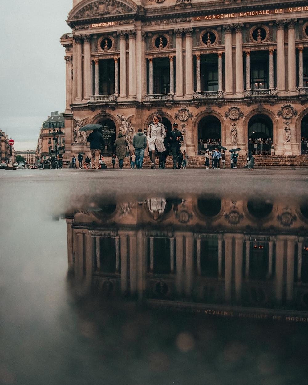 people walking near Palais Garnier Opera house in Paris, France during daytime