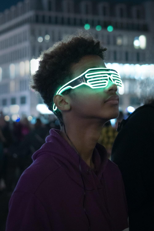 man wearing green shutter glasses