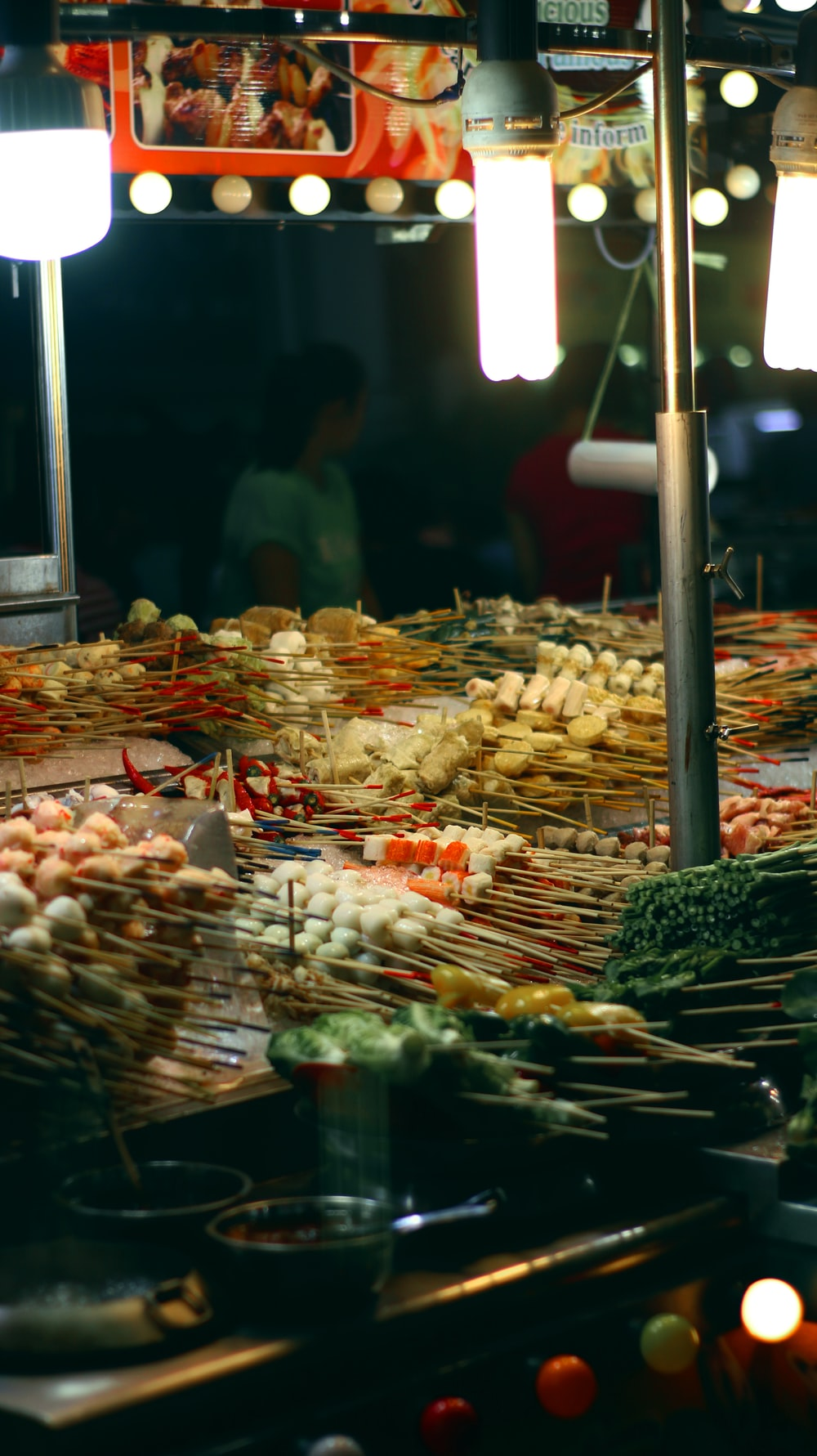 people standing near food stall during night time