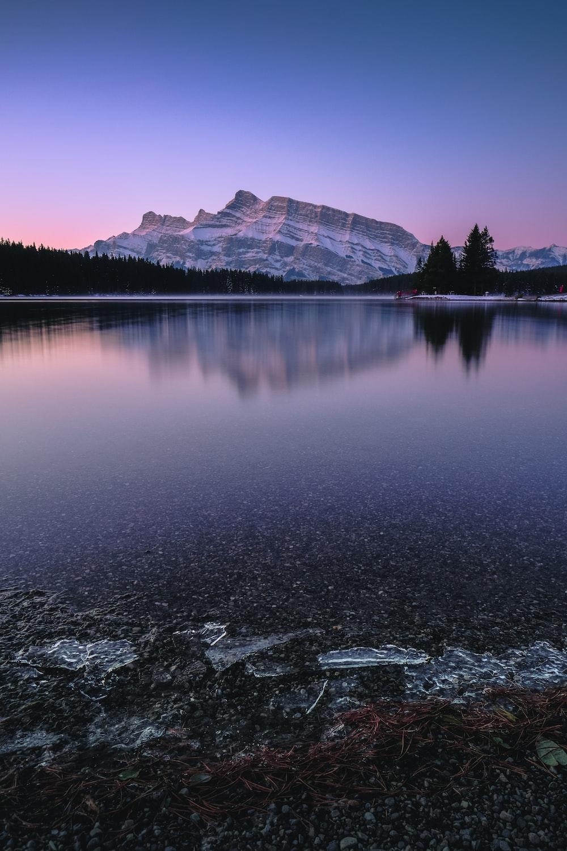 mountain near body of water
