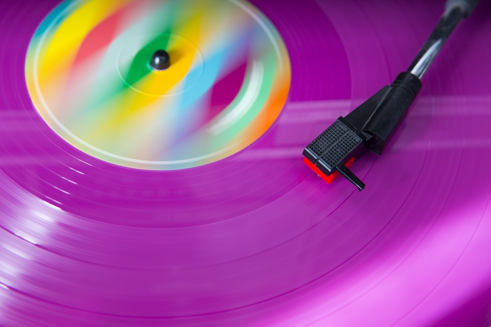purple and pink turntable