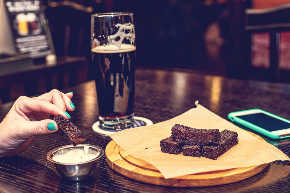 chocolate cake beside beer