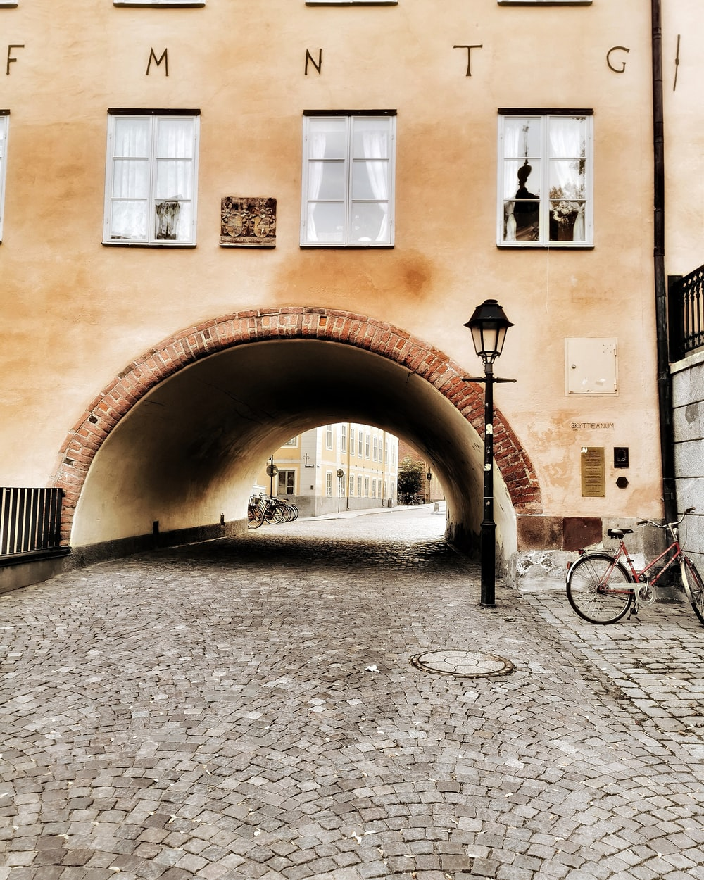brown arch tunnel beside lamp post