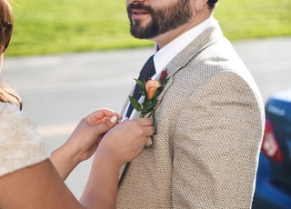 woman fixing man's blazer