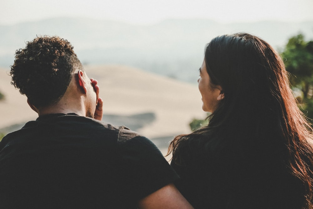couple wears black shirt