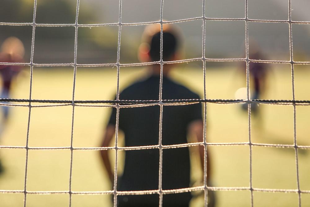 man standing near the goal post