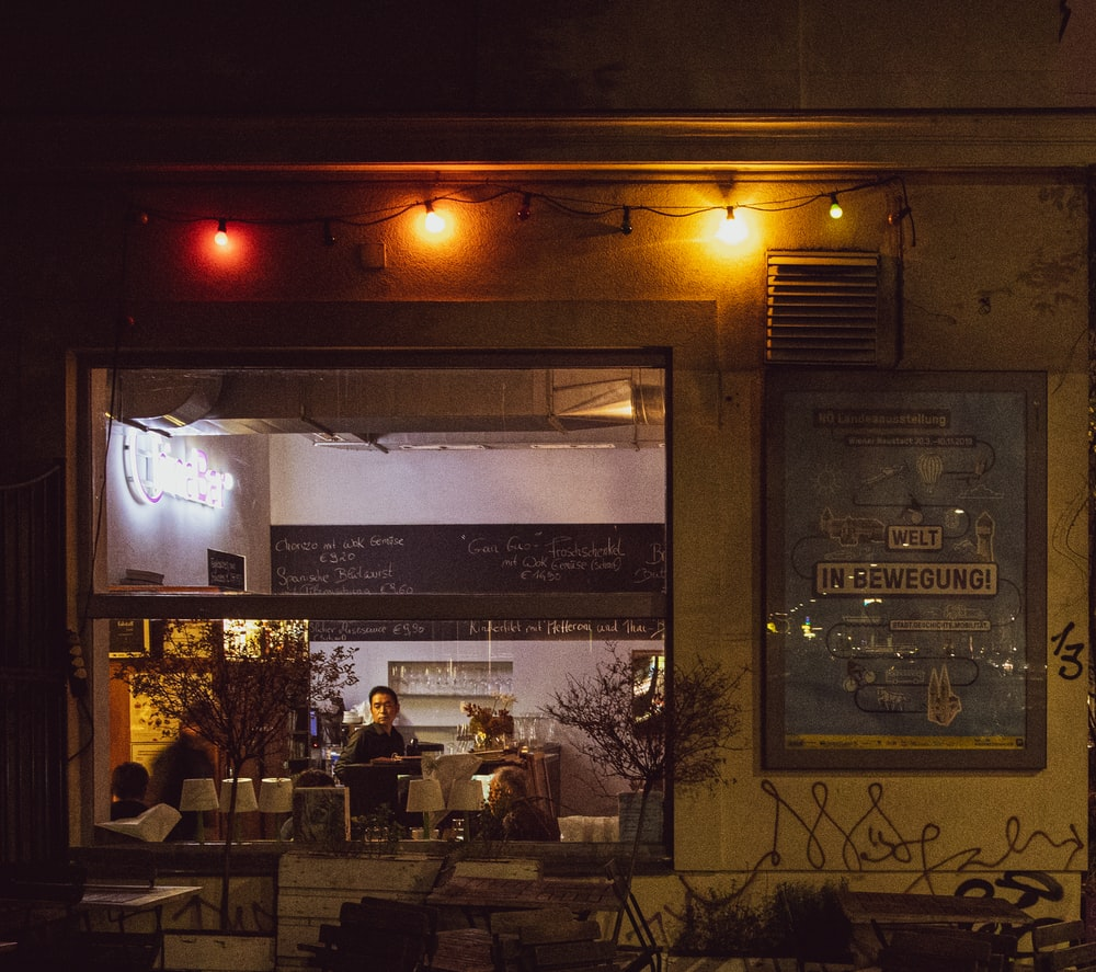 people inside restaurant during night time