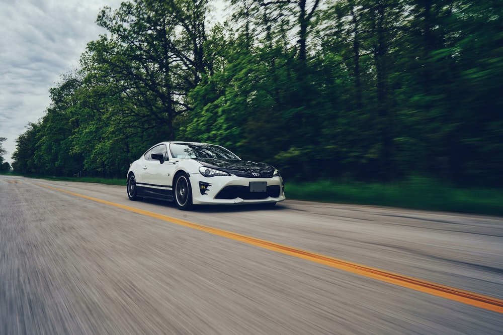white and black sports coupe