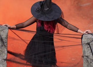 witch holding two black post