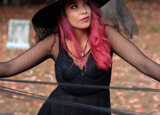 woman in black spaghetti strap dress and wearing witch hat